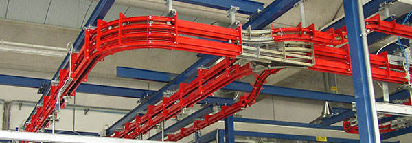 Two-rail conveyor for a metal painting company